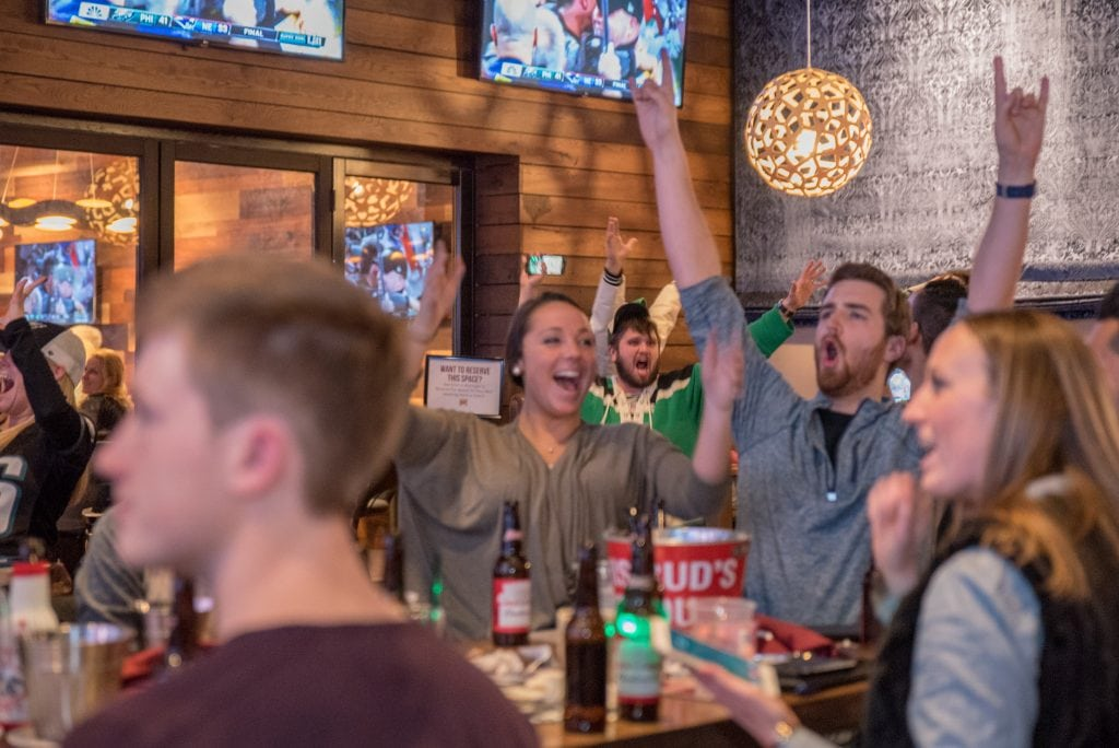 Fans celebrate a big win at Bobby V's Stamford